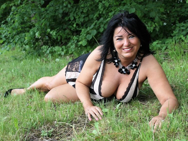 erotische mature woman with a beautiful smile
